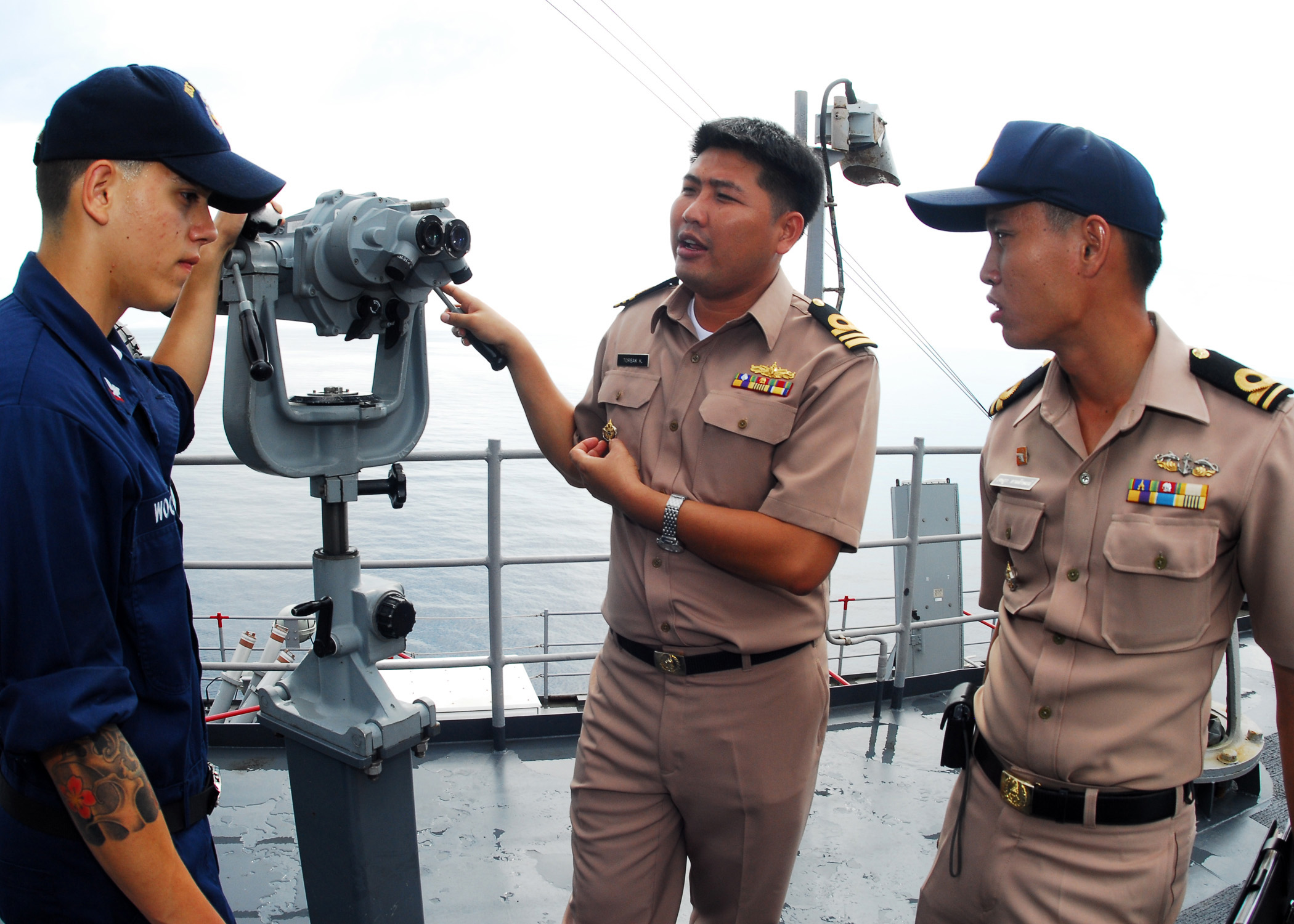 Navy 100512-N-0995C-051 Royal Thai Navy sailors explain their uniform ...