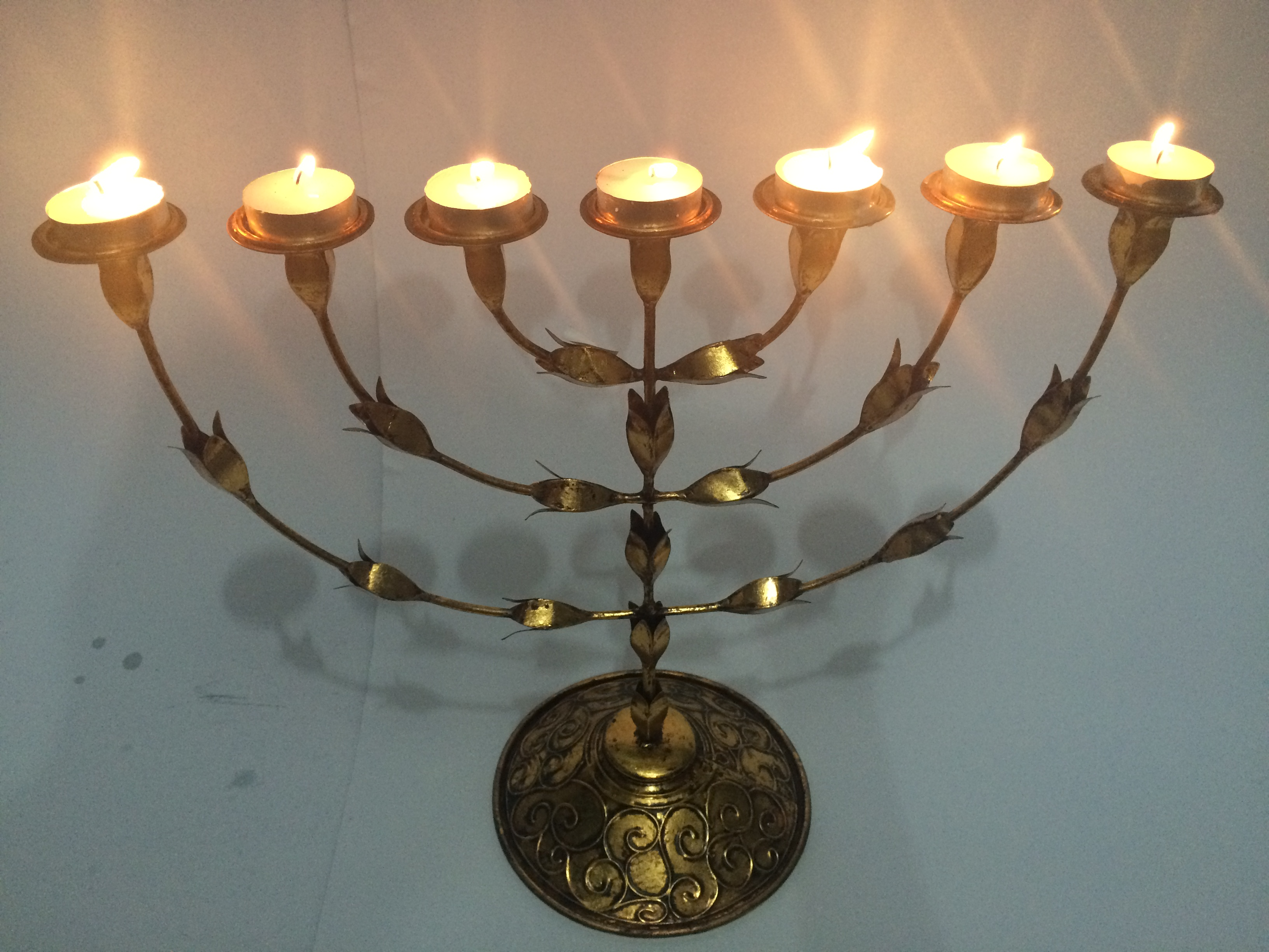 file 7 tea light candle menorah with petal design by the bluesmith