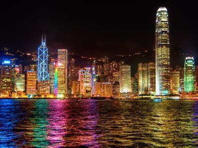 A city illuminated by colorful artificial lighting at night.jpg