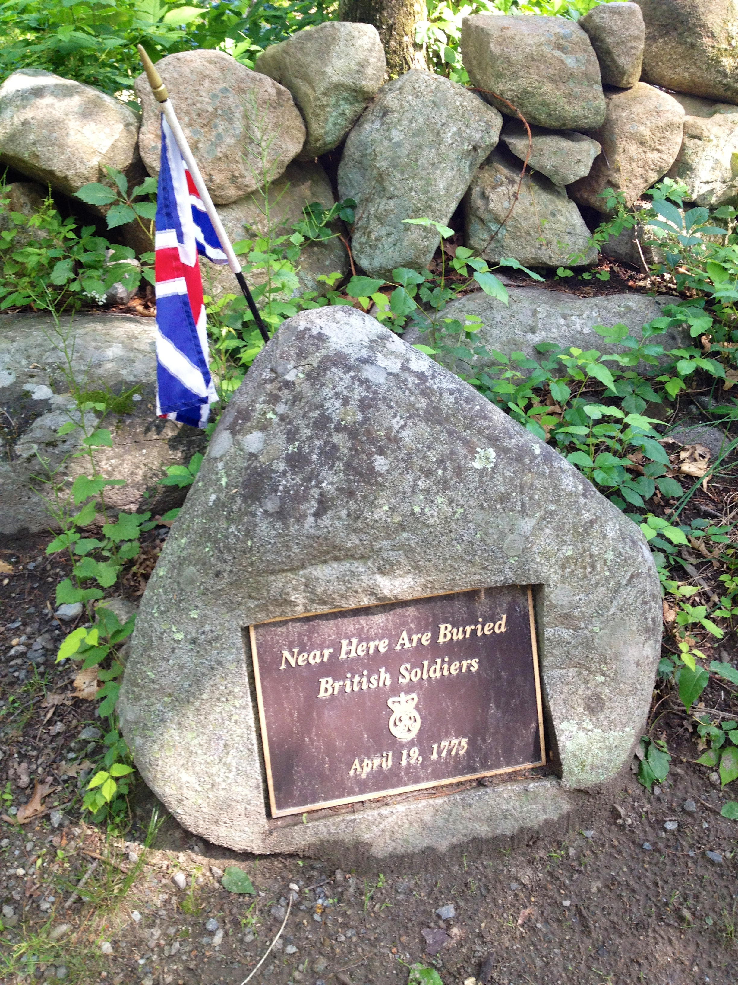 file grave marker of british soldiers along battle road in
