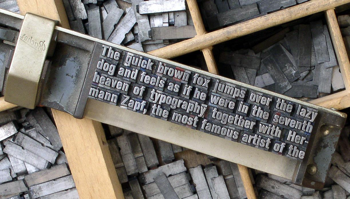 The phrase shown in metal moveable type, used in printing presses.