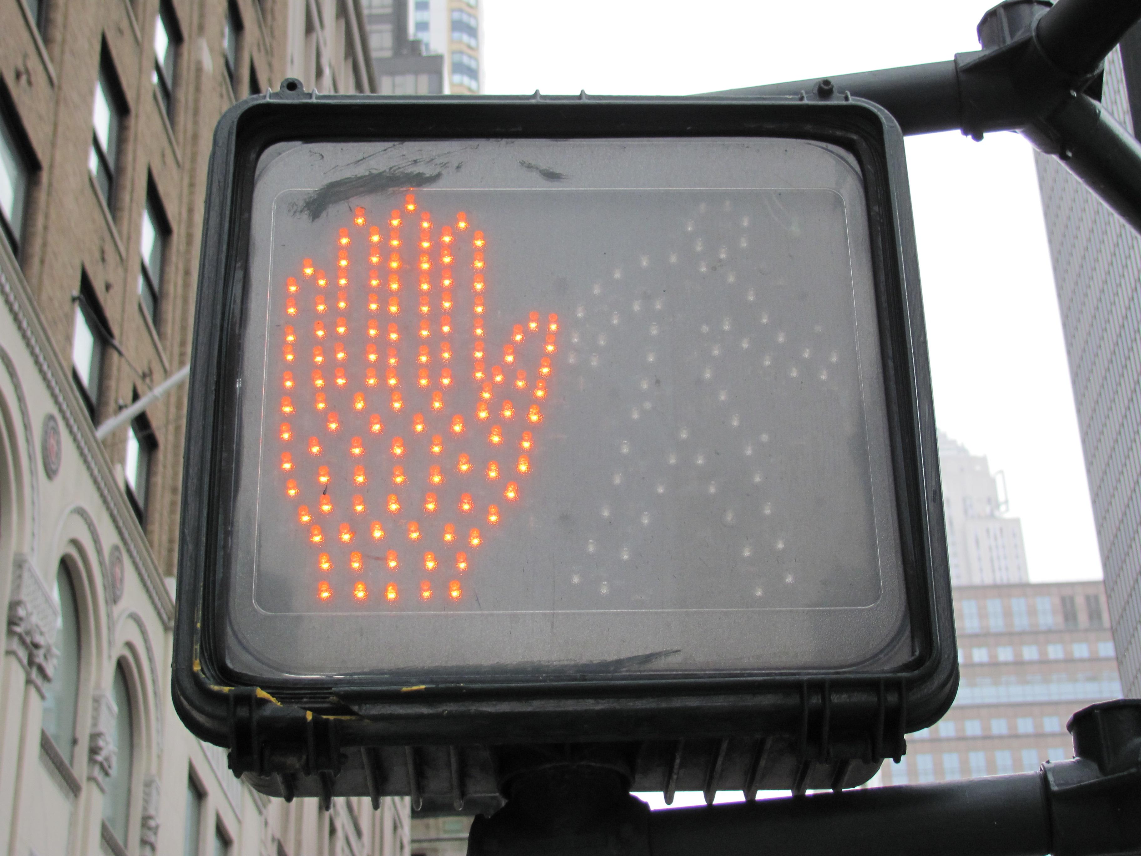 Pedestrian crosswalk sign (wait)
