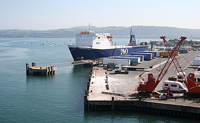 The freight ferry European Mariner lies alongside the quay at Larne, lined by trailers awaiting shipment to Troon.