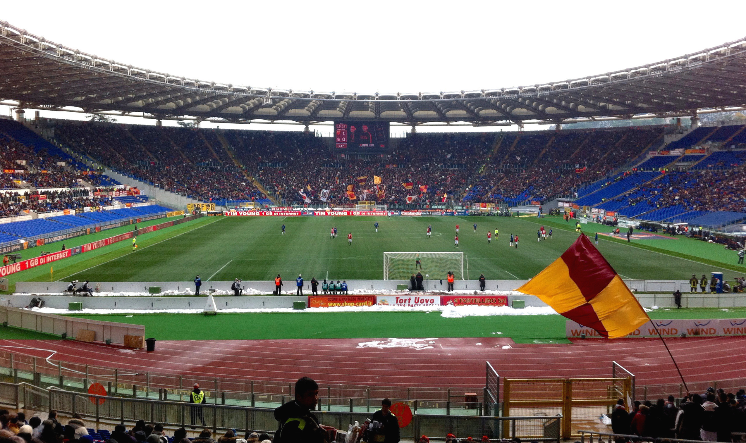 [Image: AS_Roma_fans_at_Stadio_Olimpico_during_Roma-Inter.jpg]