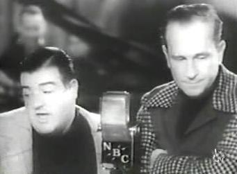 A picture of Bud Abbott and Lou Costello at a microphone