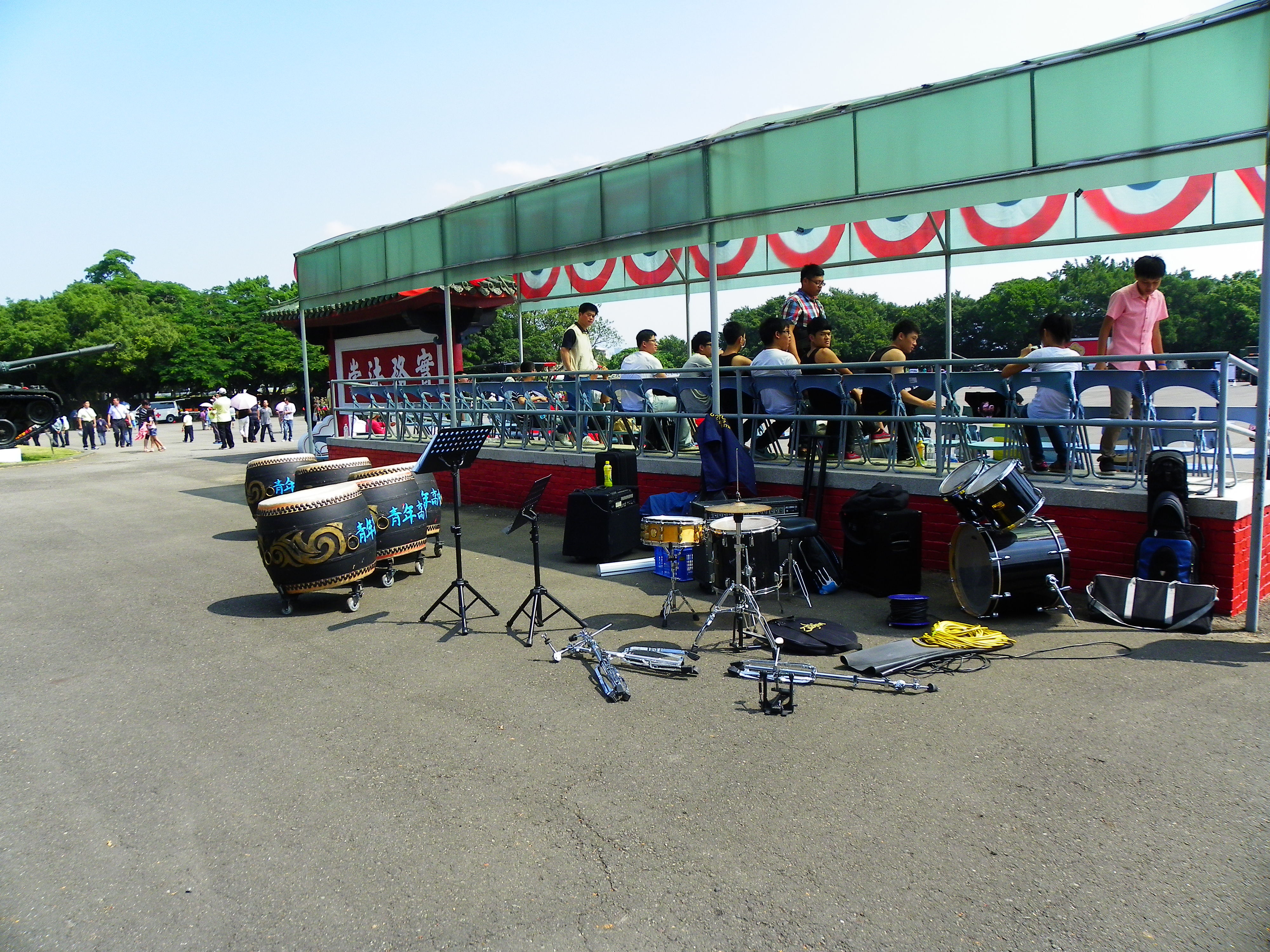 file chinese drums and drum kit beside stand ready for transport