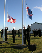 The flag of Iceland being raised and the flag of the US being lowered as the US hands over the Naval Air Station to the Government of Iceland