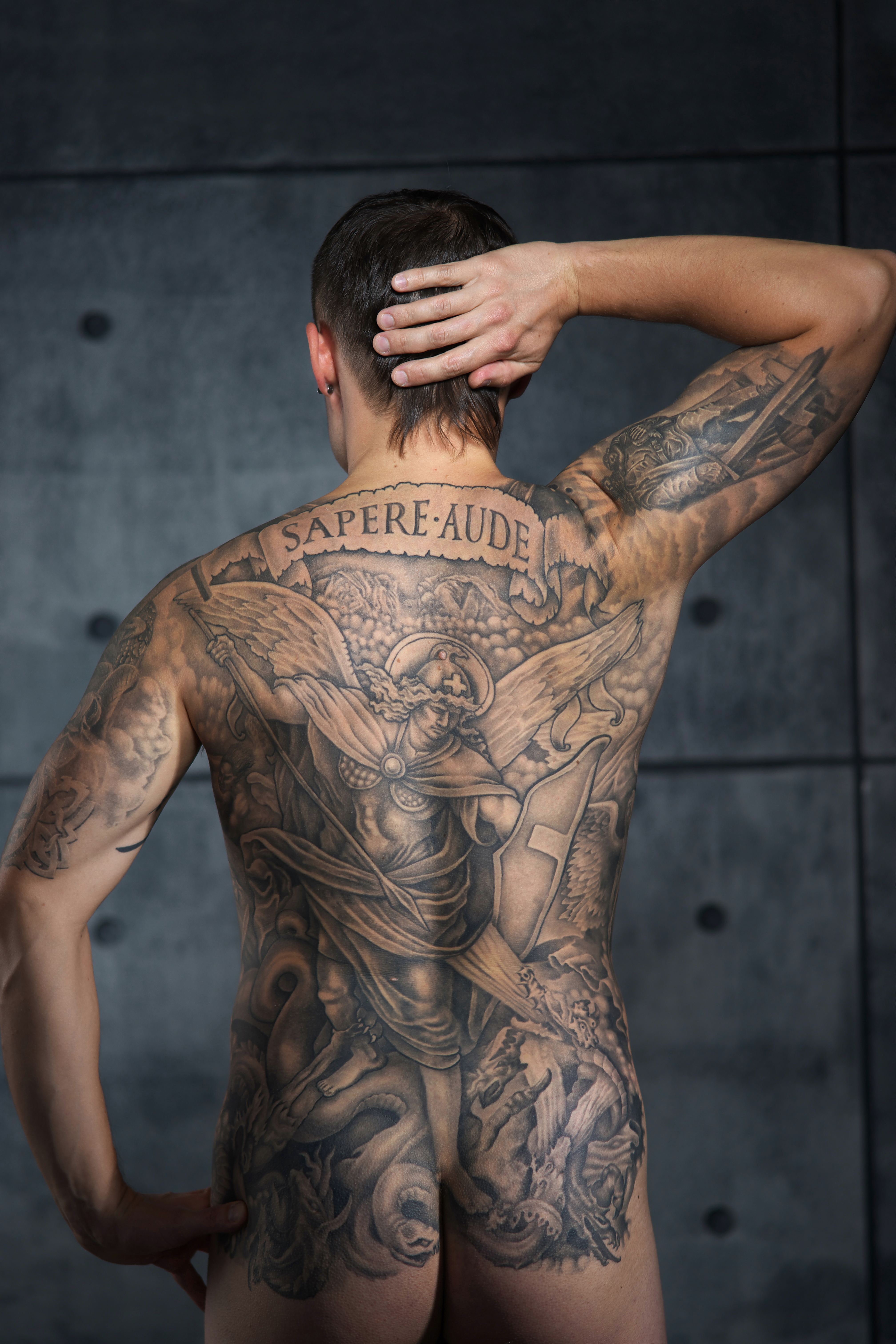 3deff61e0f66b File:Man with a full back tattoo. Color.jpg - Wikimedia Commons