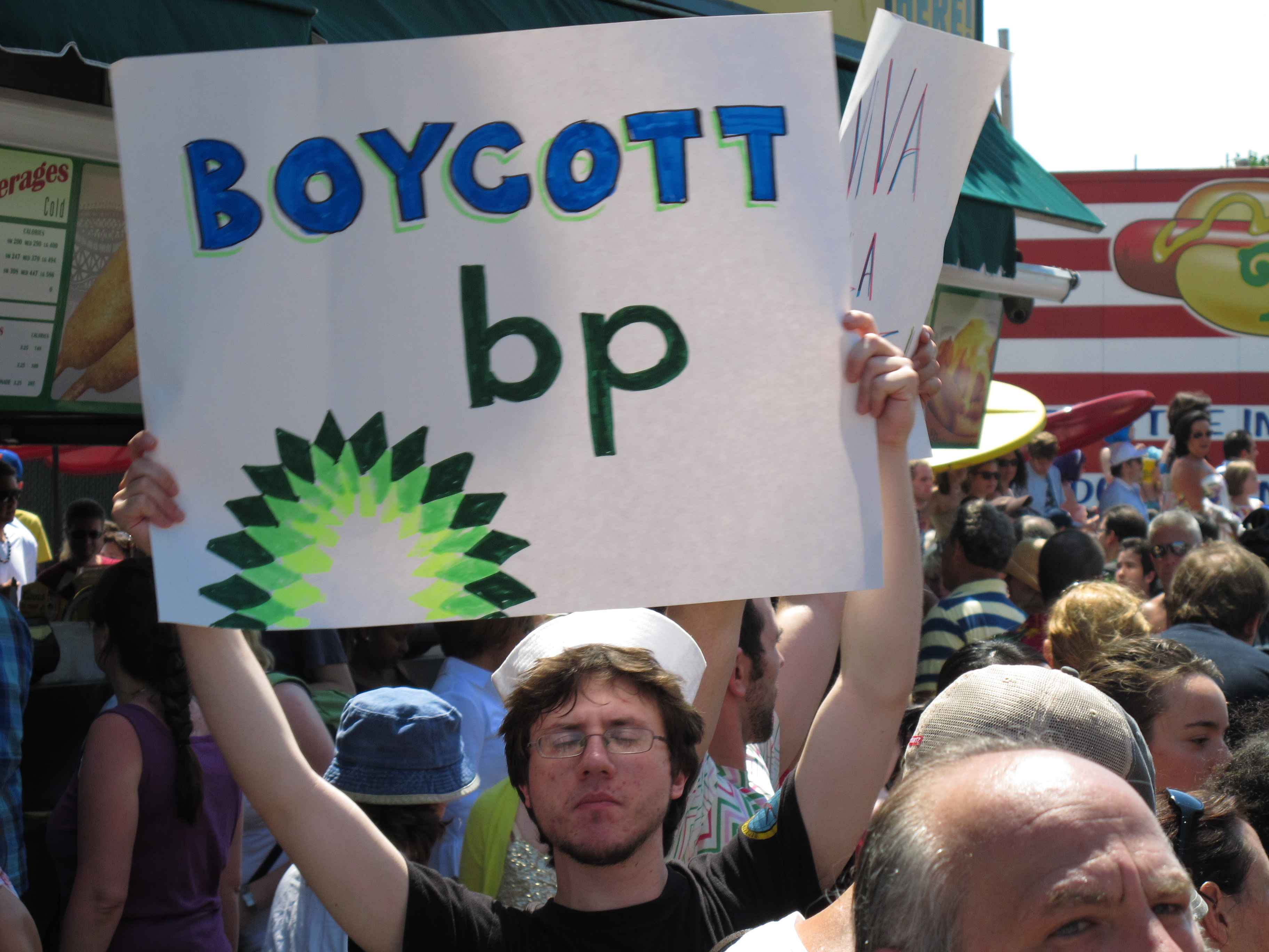 Protester with Boycott BP sign
