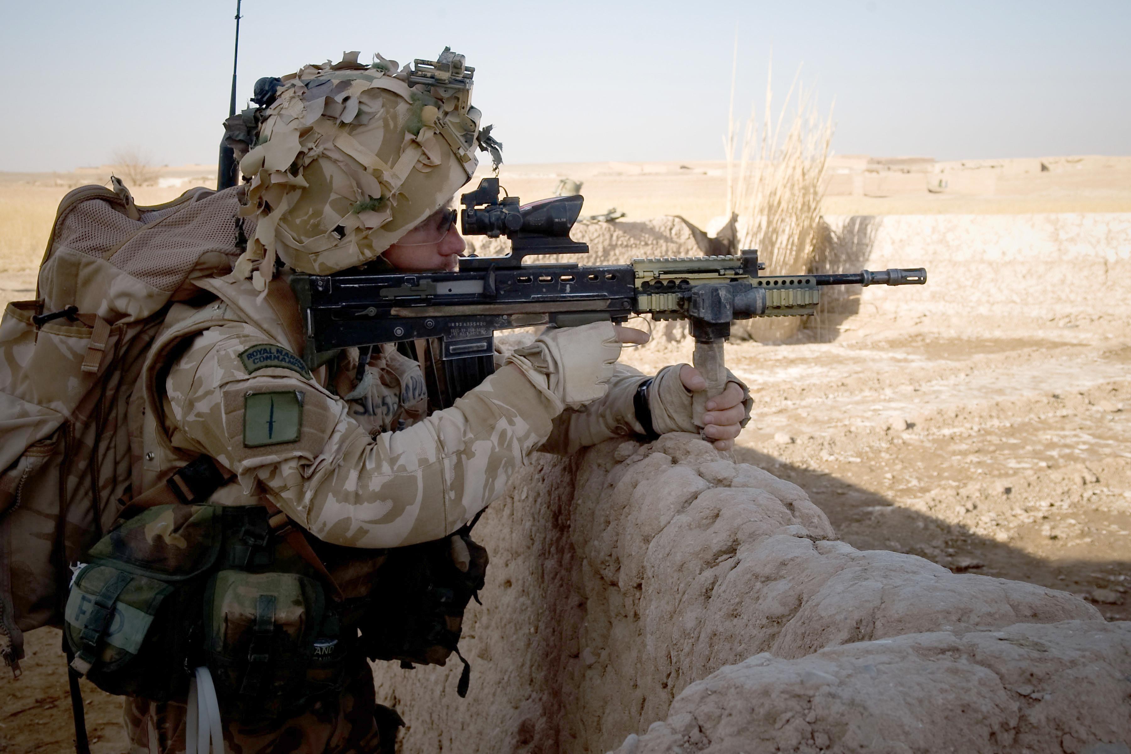 A Royal Marine aims his L85A2 assault rifle.