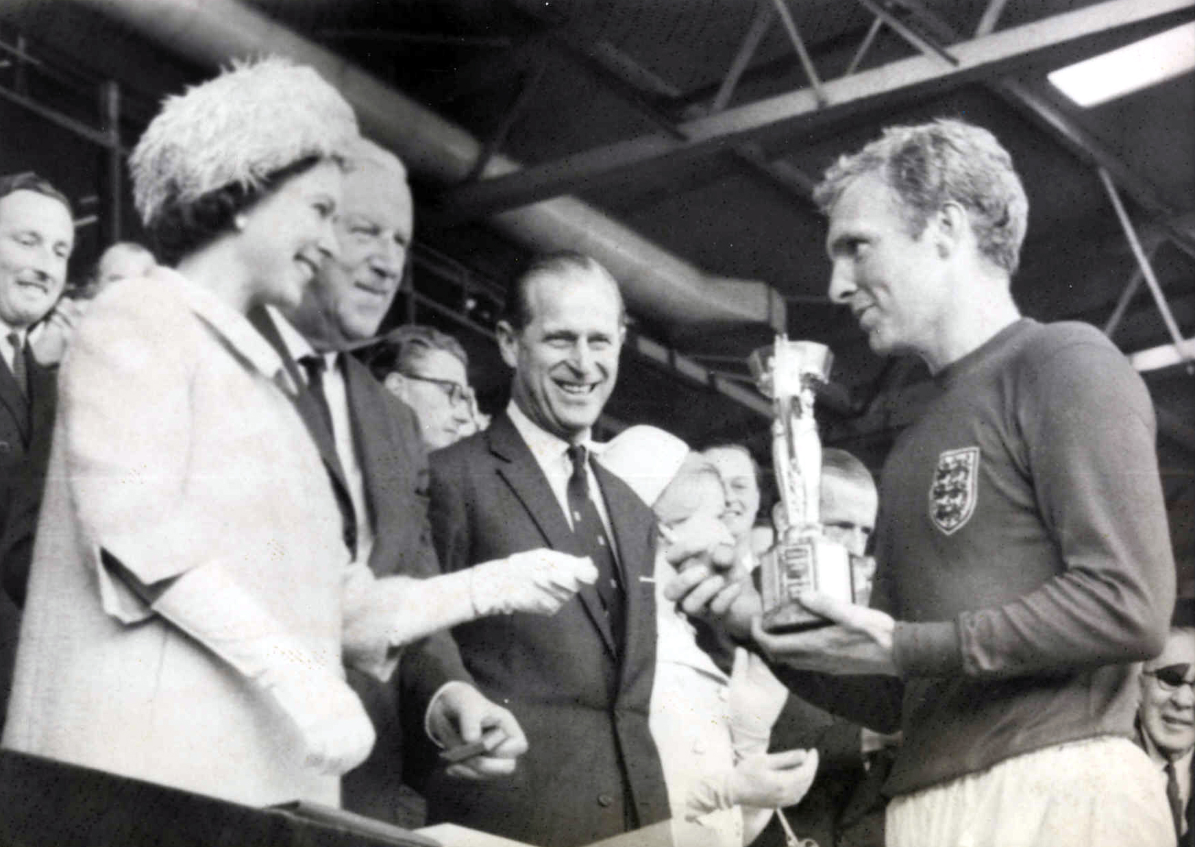 File:The Queen presents the 1966 World Cup to England Captain, Bobby Moore.