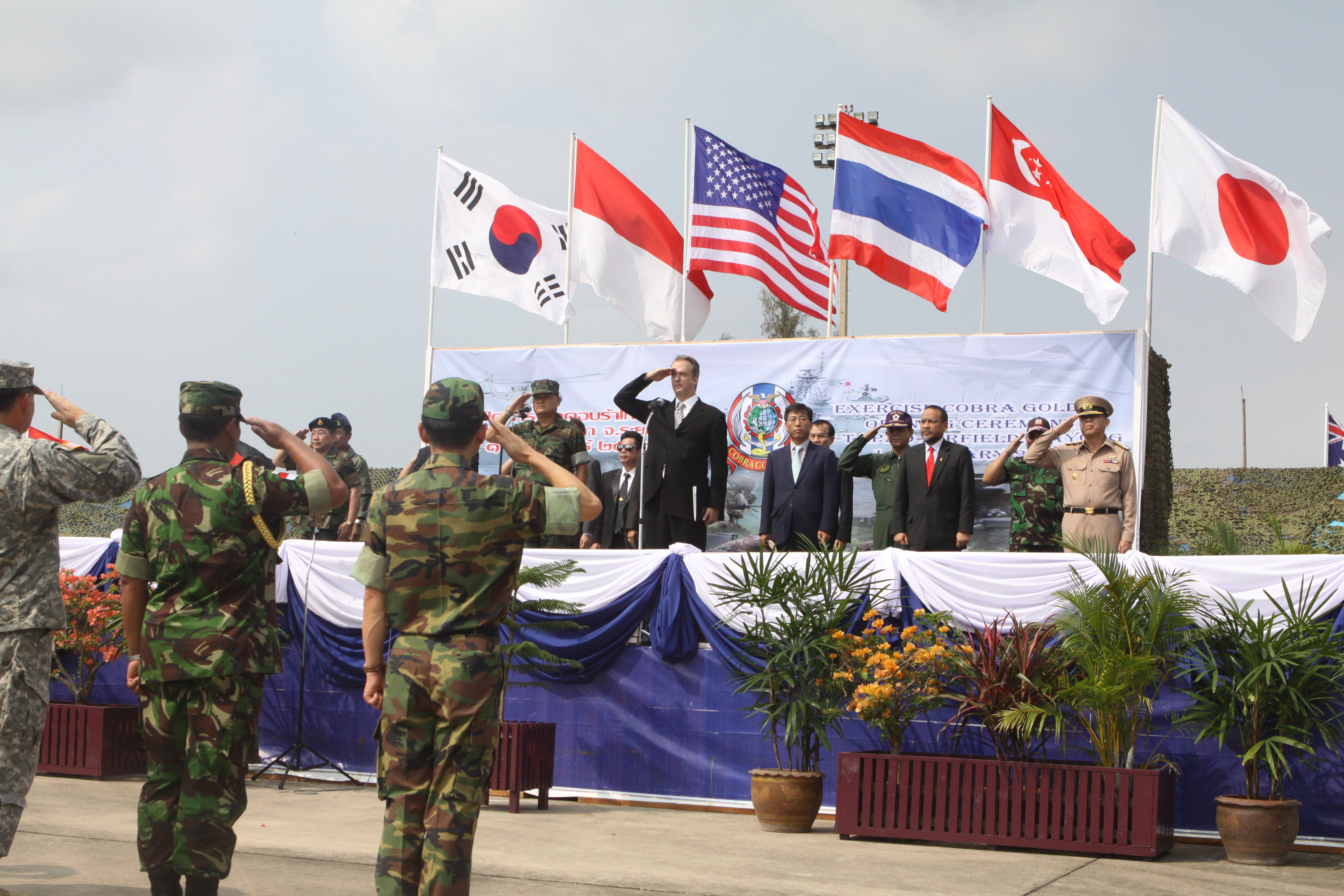 File:US Navy 100201-M-4593D-100 Military members stand at