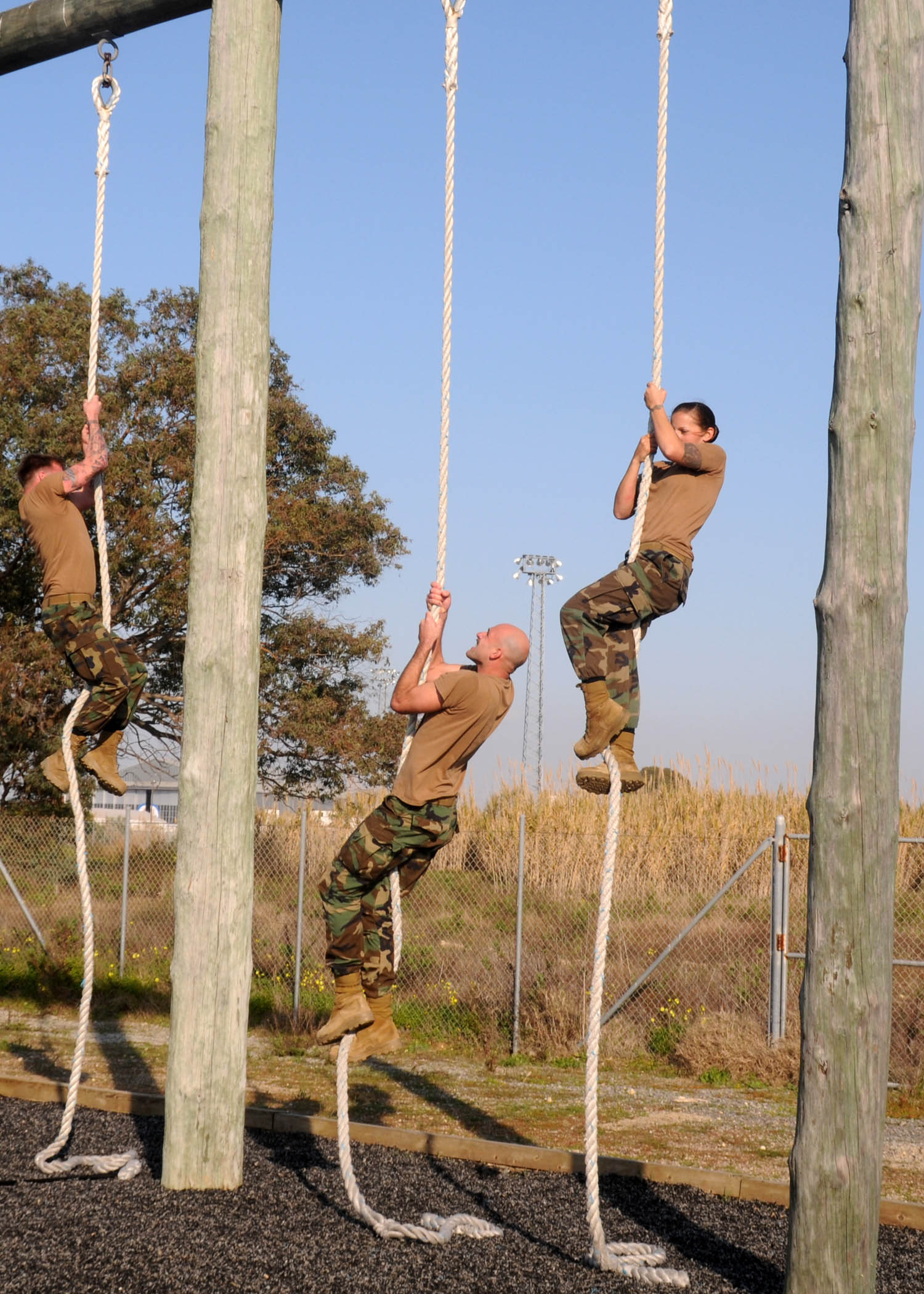 Construction nmcb 74 attempt the marine corps obstacle course at