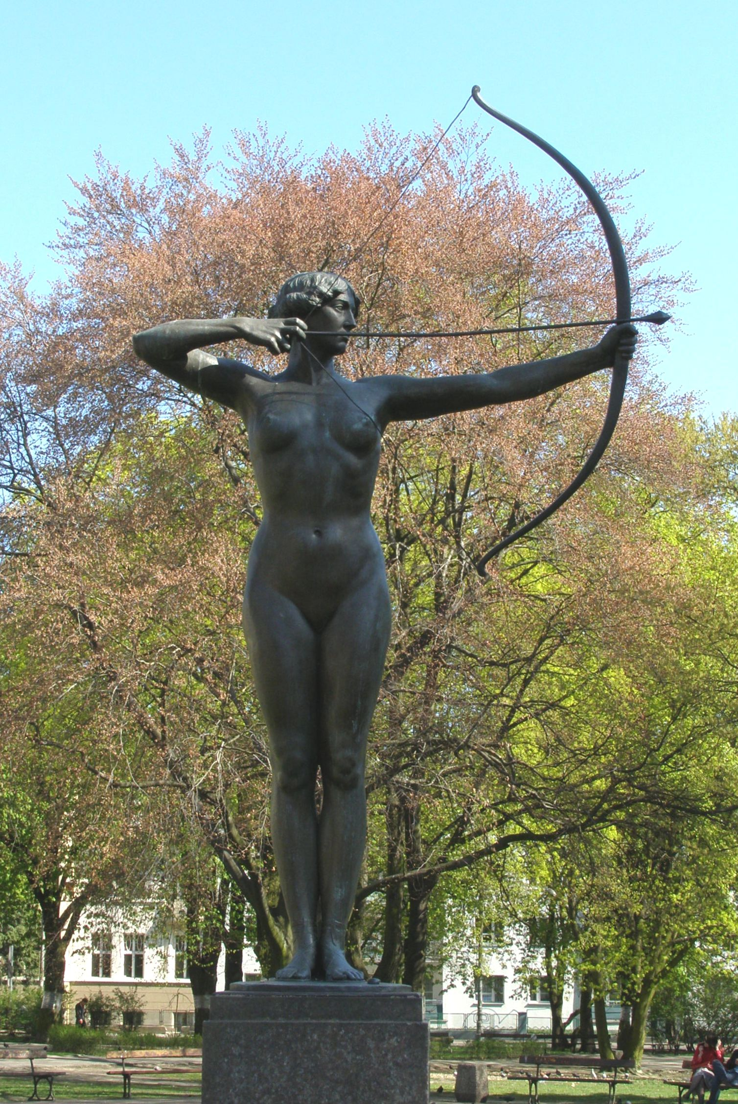 Statue of naked woman in Bydgoszcz, Poland, stanced with open bow and arrow