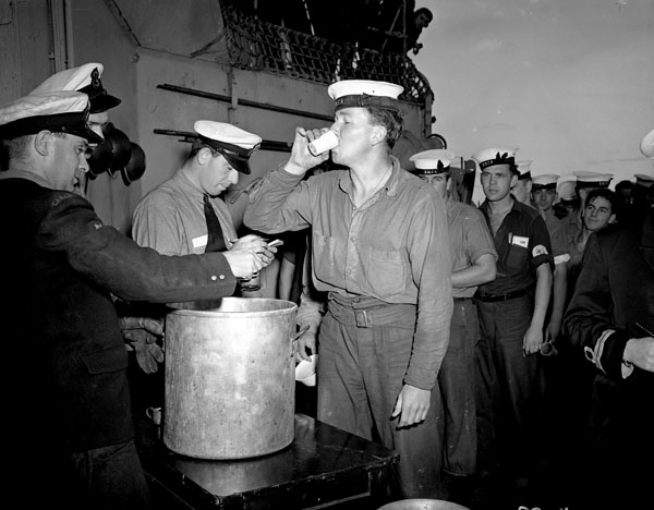 Canadian sailors celebrate V-J-Day with drinks