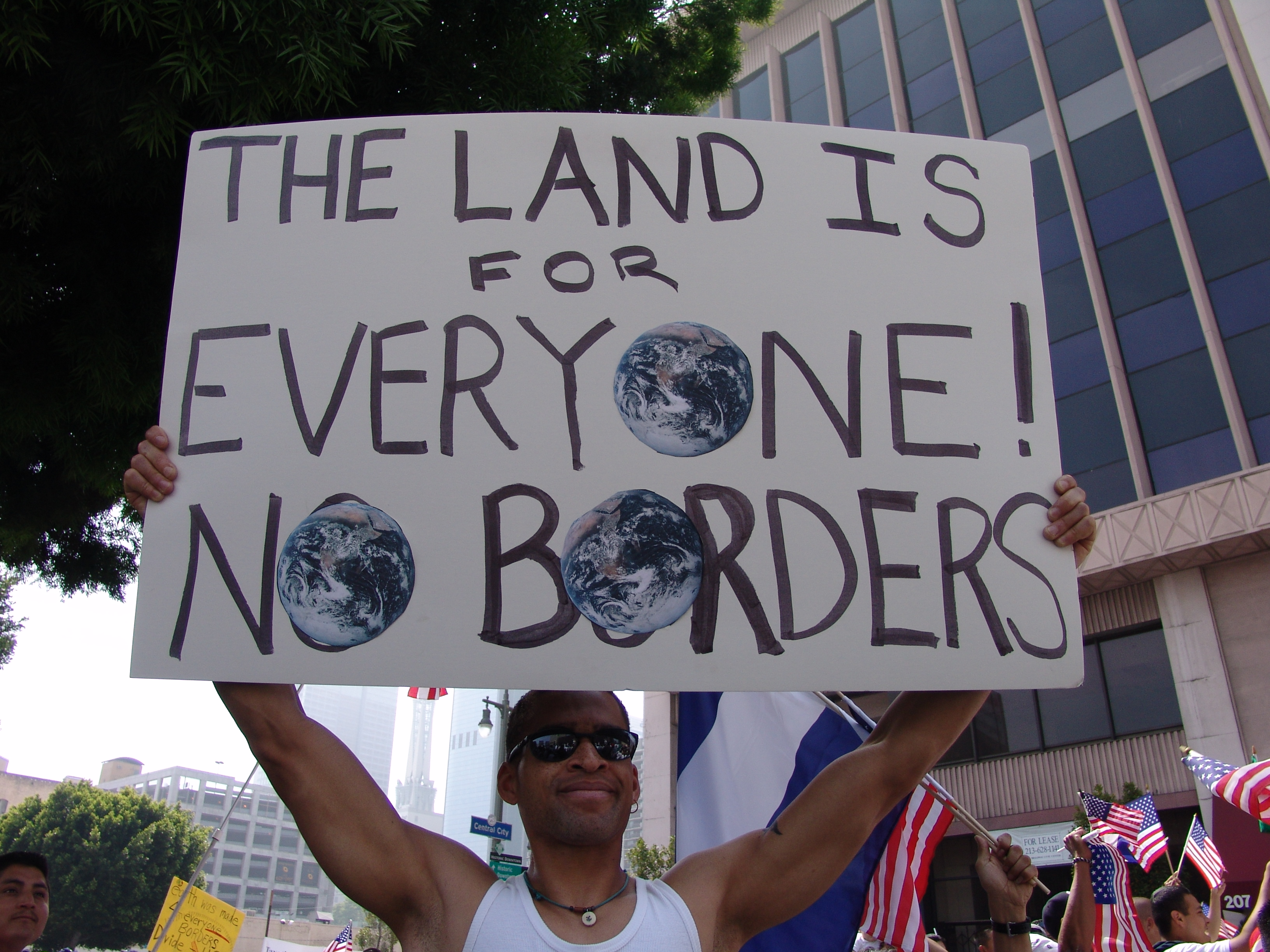 on     May Day Immigration March, 2006.  Posted on Wikimedia Commons by Jonathan McIntosh.