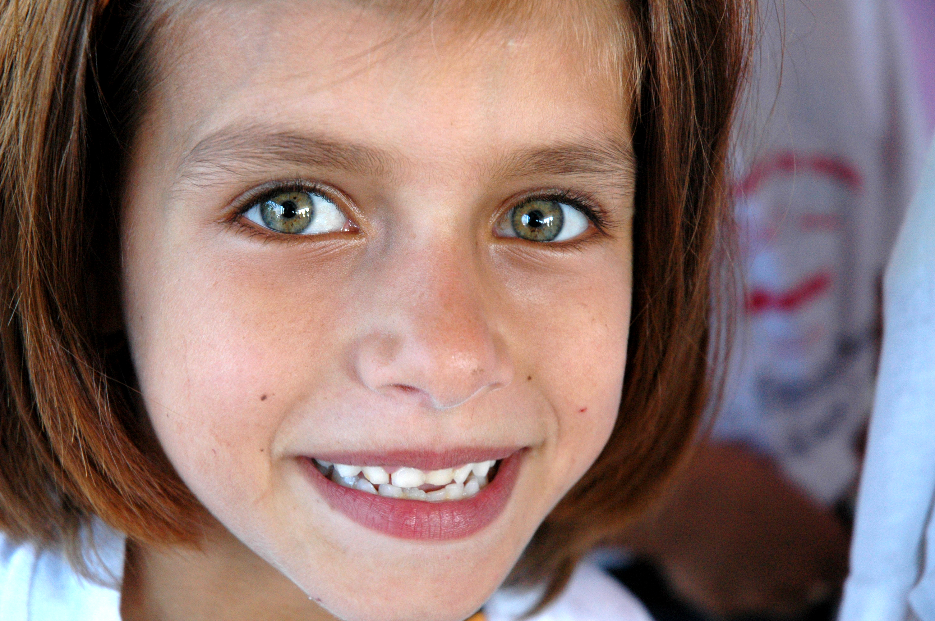 A Palestinian girl with natural chestnut hair.