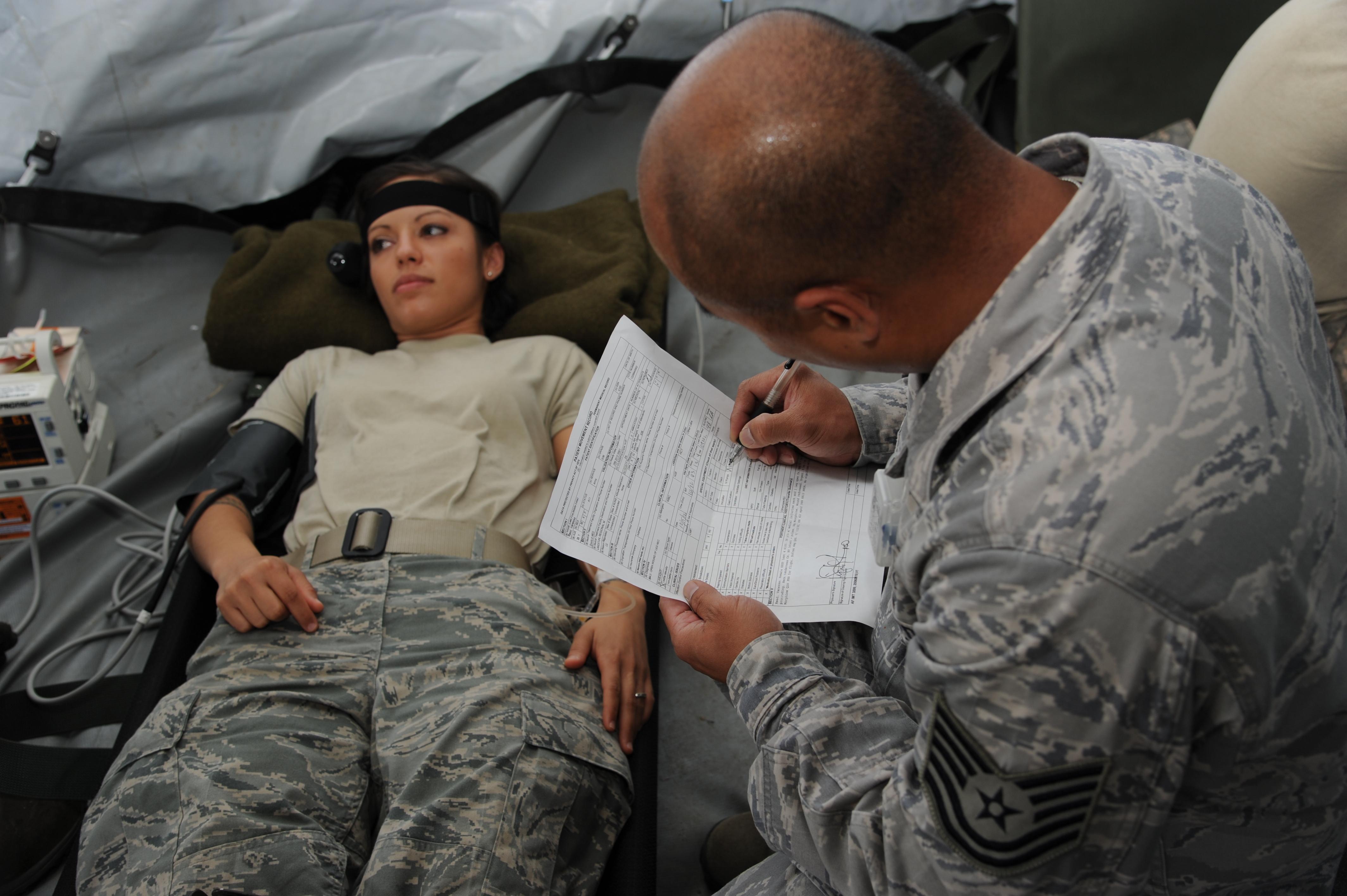 Medical Charts: U.S. Air Force Tech. Sgt. Joel Narvaza right a medical ,Chart