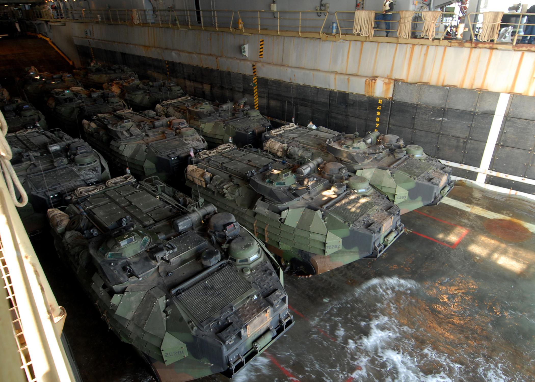 US_Navy_081229-N-9134V-036_Amphibious_assault_vehicles_prepare_to_disembark_from_the_well_deck_of_the_amphibious_dock_landing_ship_USS_Carter_Hall_%28LSD_50%29.jpg