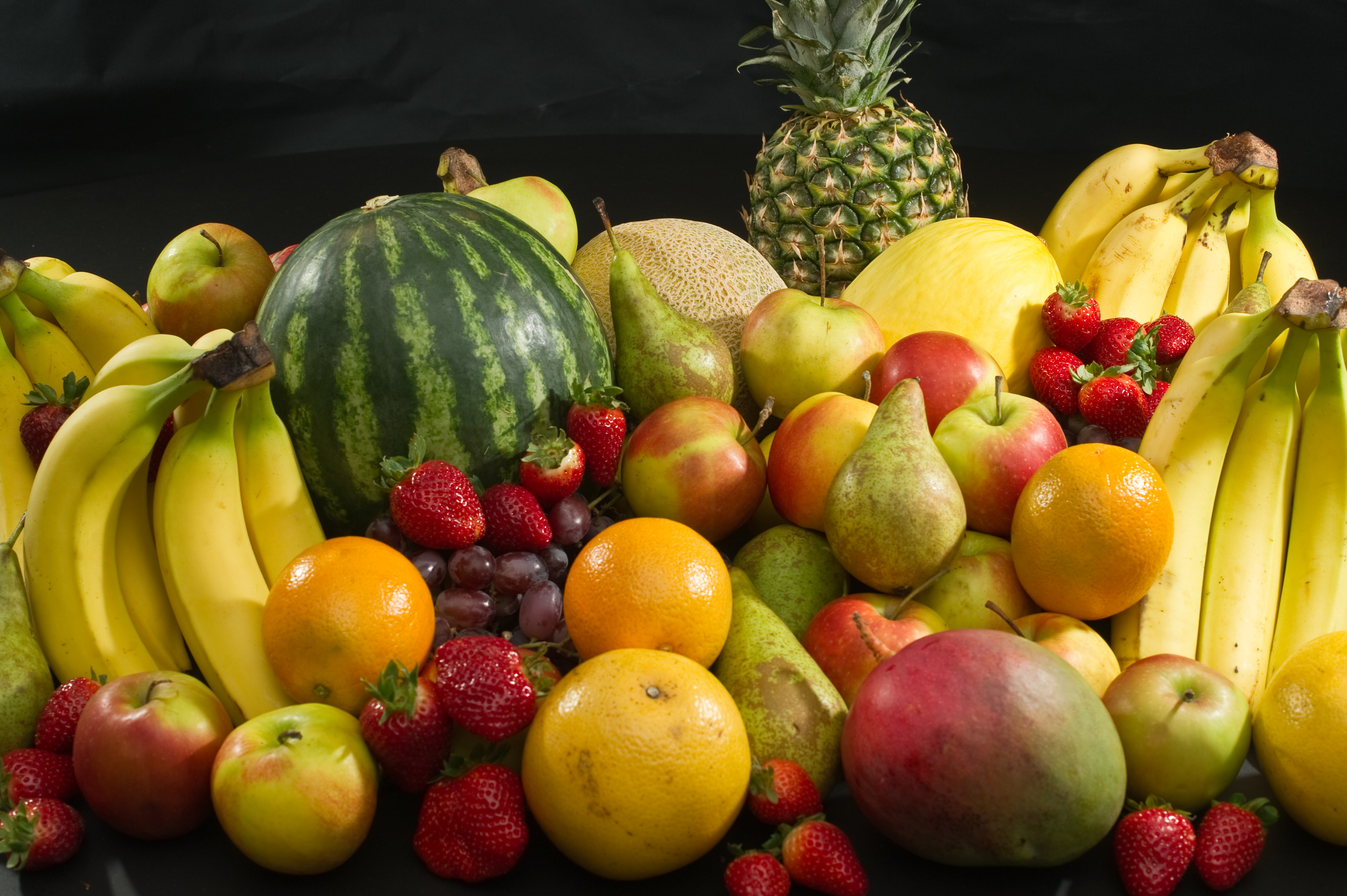 healthy diet common colorful culinary fruits apples pears strawberries oranges bananas grapes canary melons watermelon cantaloupe pineapple and mango