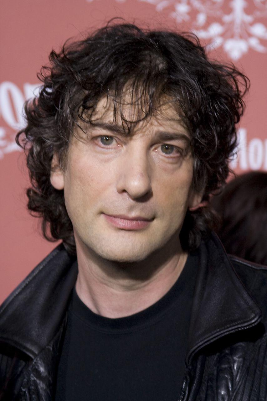 Neil Gaiman  - 2018 Dark brown hair & alternative hair style.