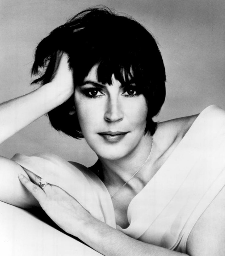http://upload.wikimedia.org/wikipedia/commons/2/2f/Helen_Reddy_1975.JPG