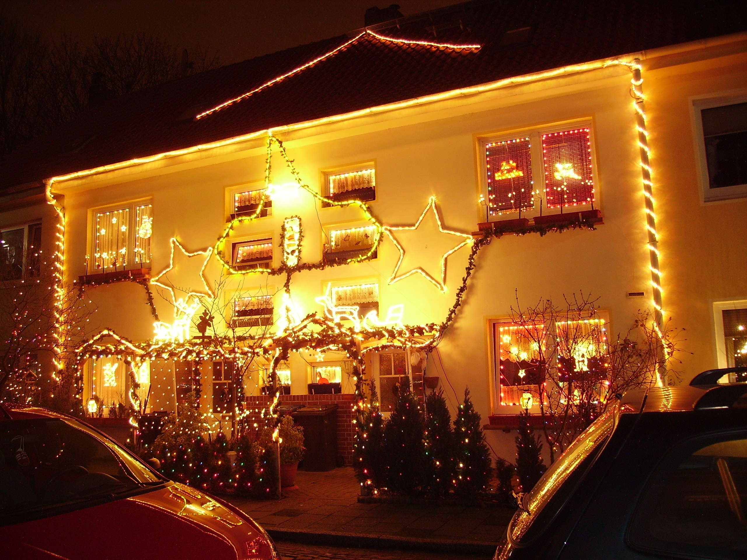 Christmas house decorations with beautiful lighting and Holiday decorated homes