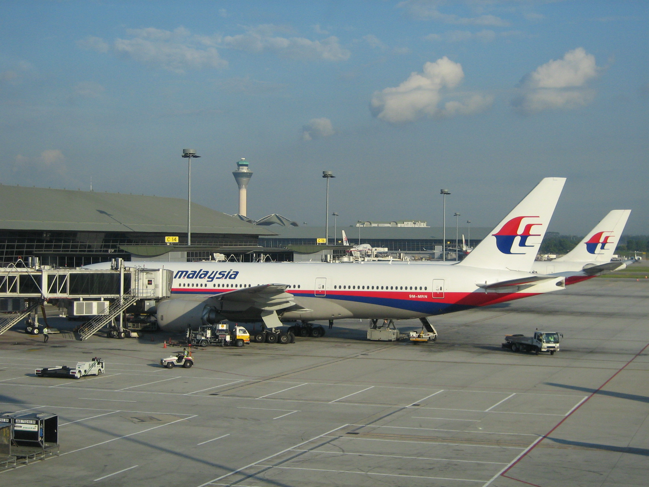 Malaysia Airlines airplanes at Kuala Lumpur International Airport, in front a Boeing 777. (Credit: Craig)