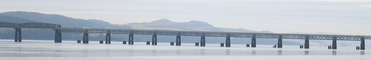 Northern segment of the second Tay Bridge, showing stumps of the original bridge's piers poking above the Tay