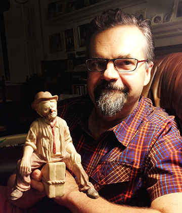 Production designer Paul Harrod with Sad Clown, one of his earliest commercial sculptures.