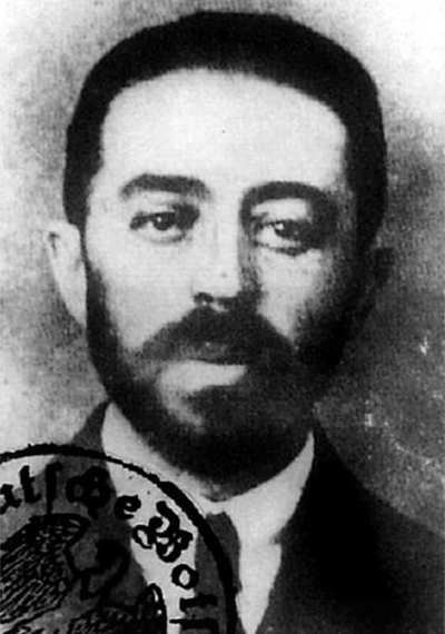 Cropped 1918 passport photo of famous espionage agent Sidney Reilly. This passport was issued under his alias of George Bergmann