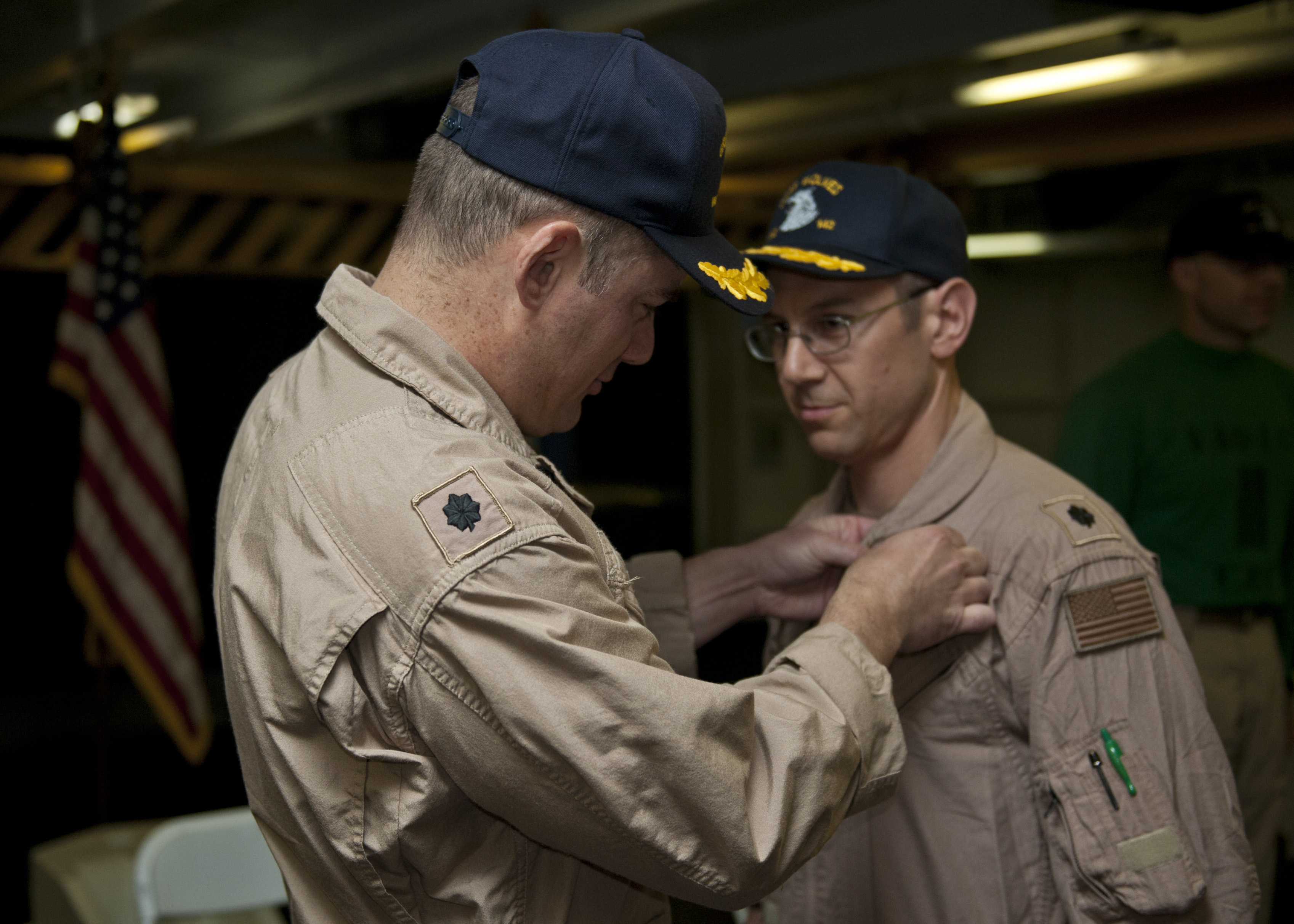 File:U S  Navy Cmdr  Edwin S  Grohe attaches a command pin