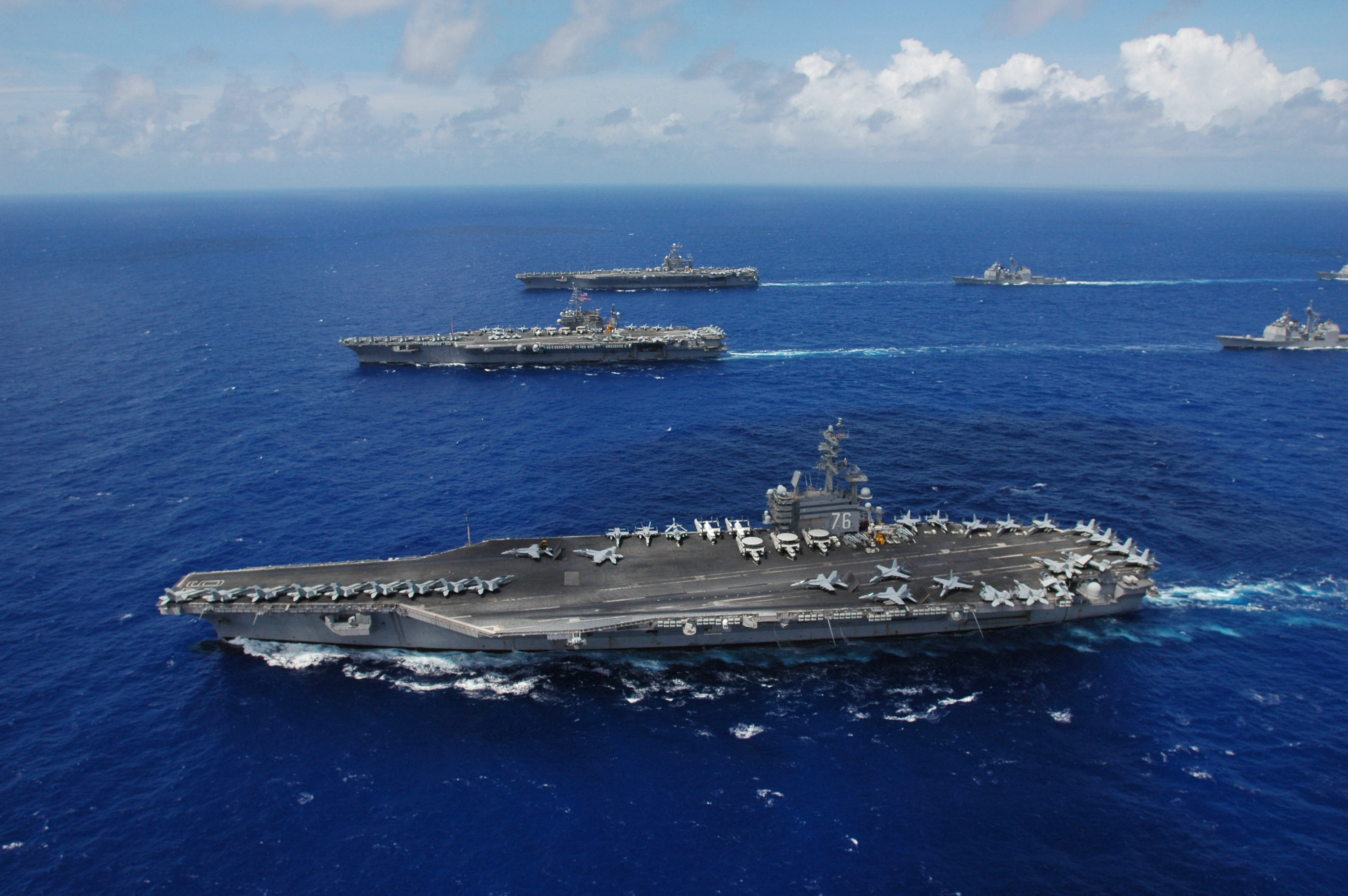 http://upload.wikimedia.org/wikipedia/commons/2/2f/US_Navy_060618-N-8492C-276_The_Nimitz-class_aircraft_carrier_USS_Ronald_Reagan_(CVN_76),_foreground,_USS_Kitty_Hawk_(CV_63),_center,_USS_Abraham_Lincoln_(CVN_72)_and_their_associated_carrier_strike_groups_steam_in_formation.jpg
