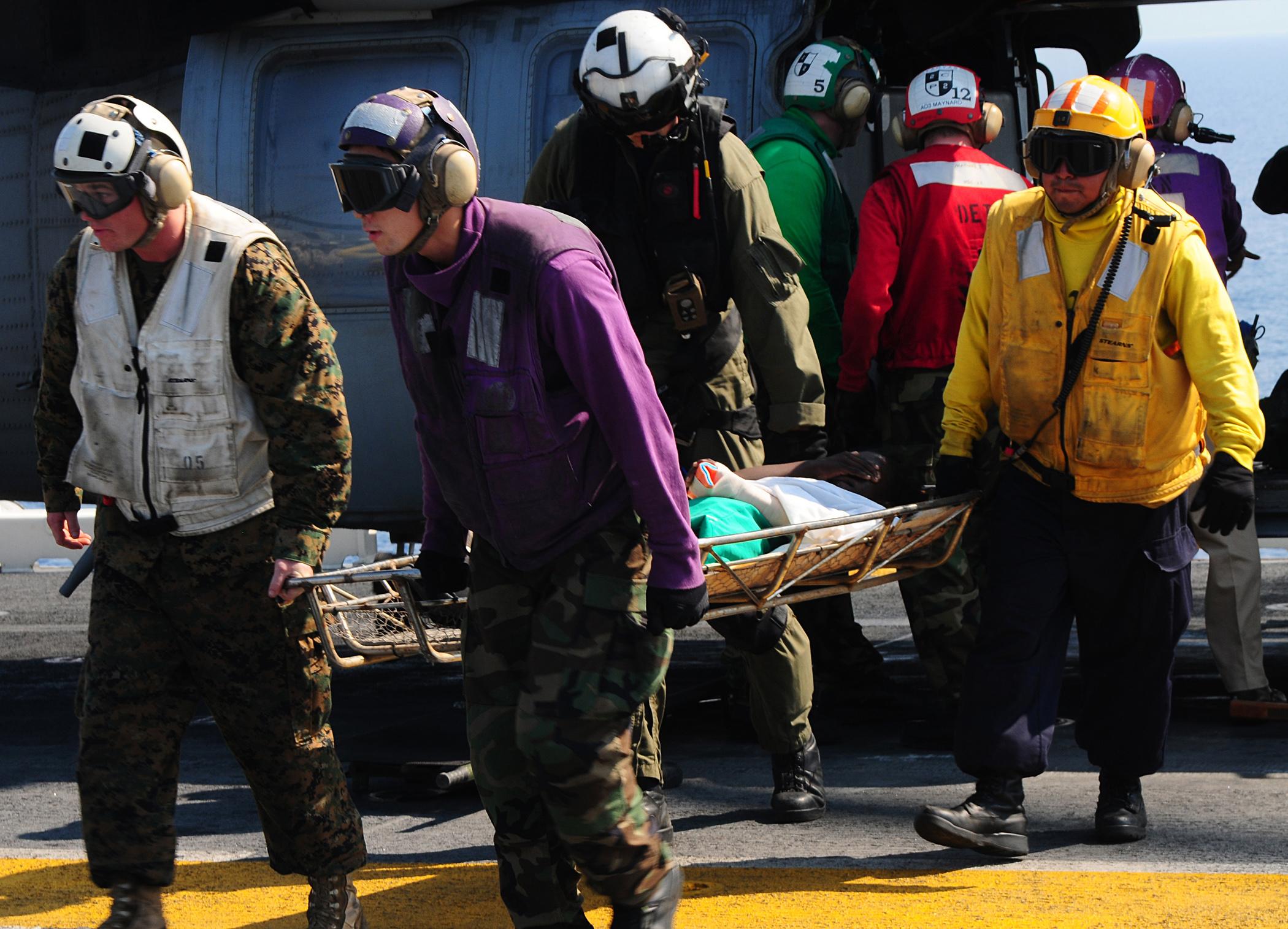 File:US Navy 100120-N-7508R-213 Fight deck crew members