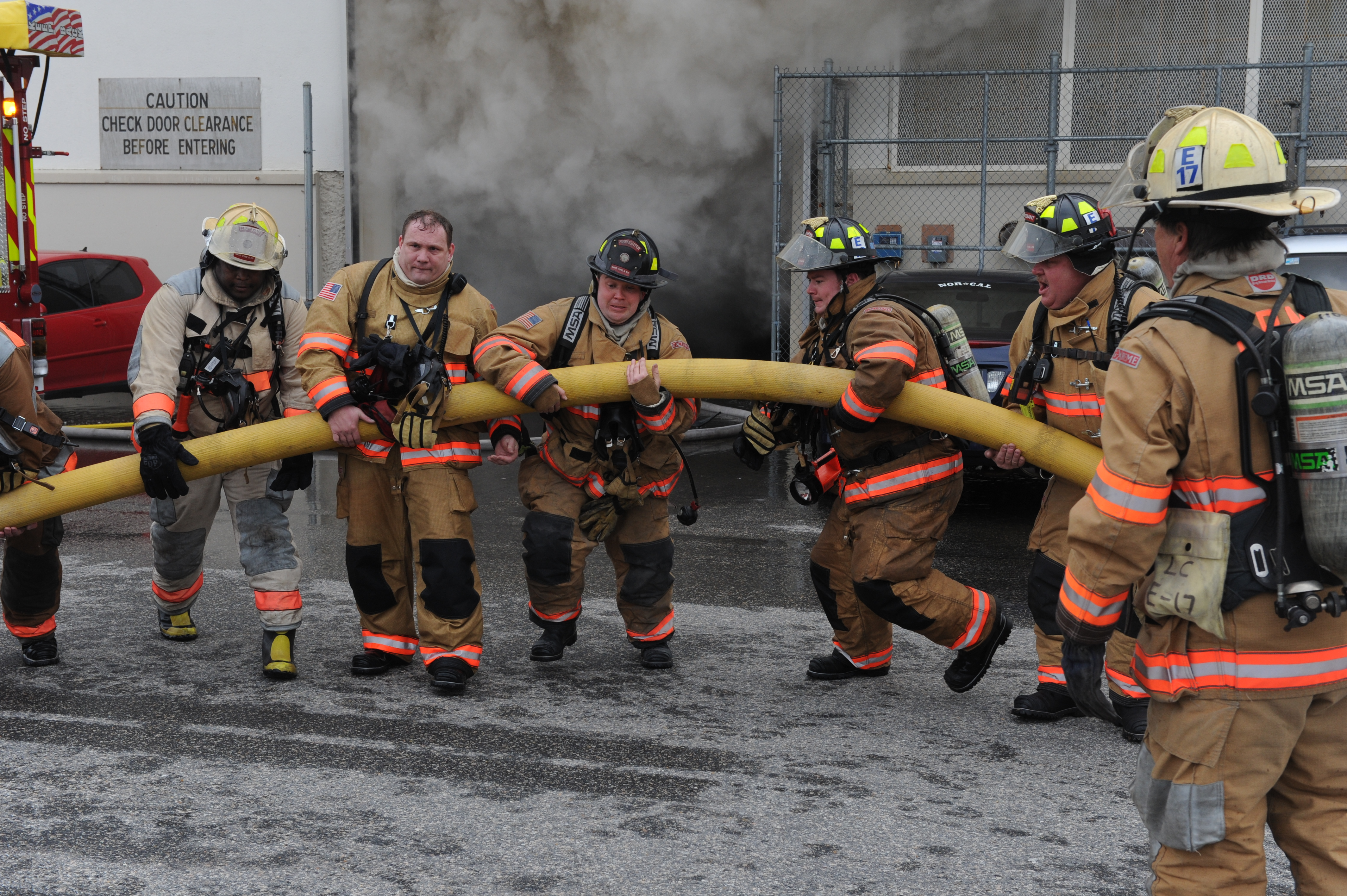 File:US Navy 110127-N-3478R-108 Firefighters extinguish a ...