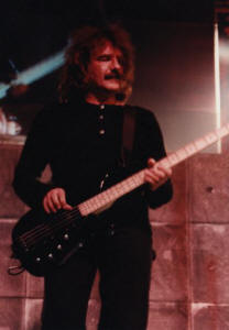 Geezer Butler performing with Black Sabbath in 1995