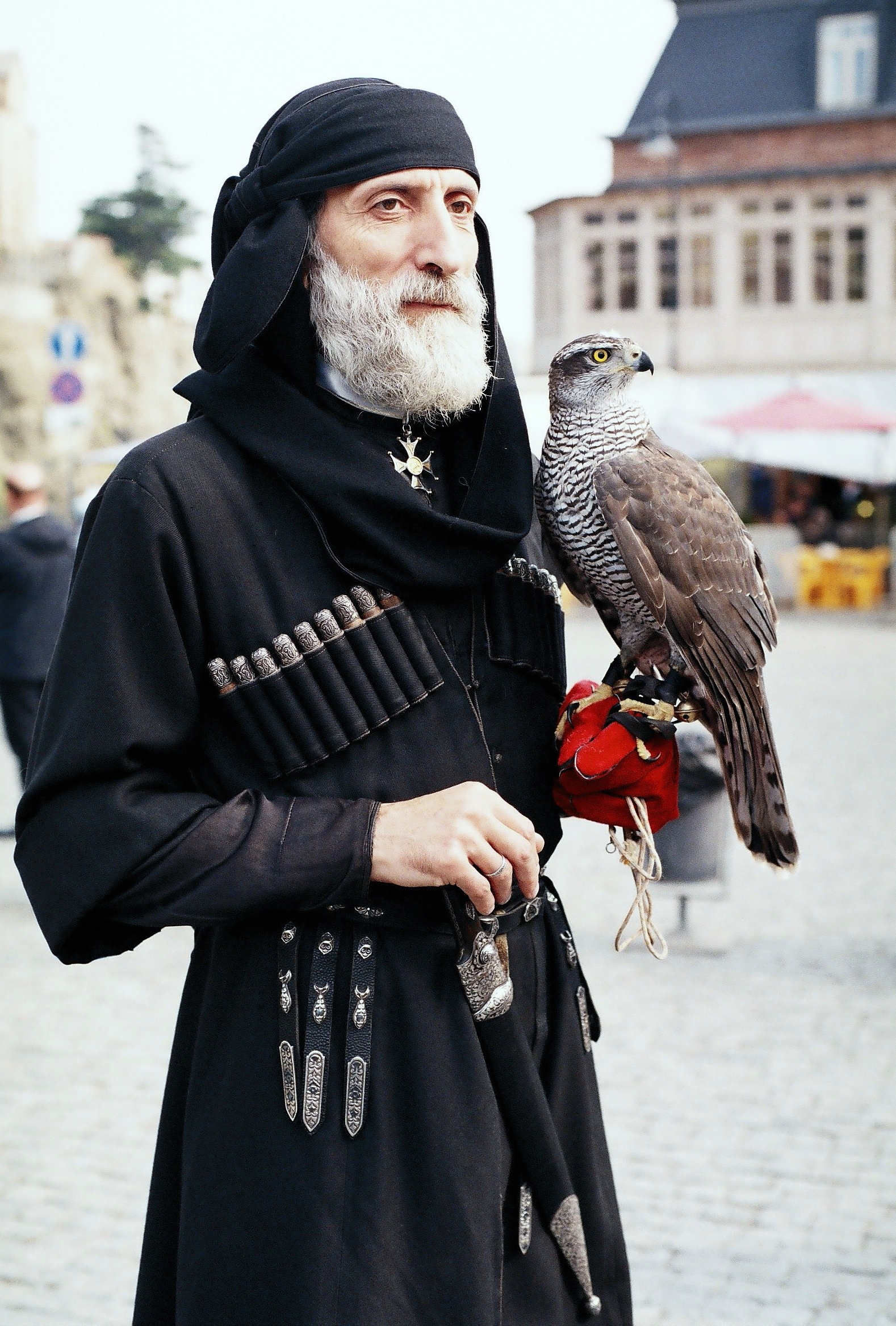 Georgian man with a falcon wearing a Chokha during the Tbilisoba festival.