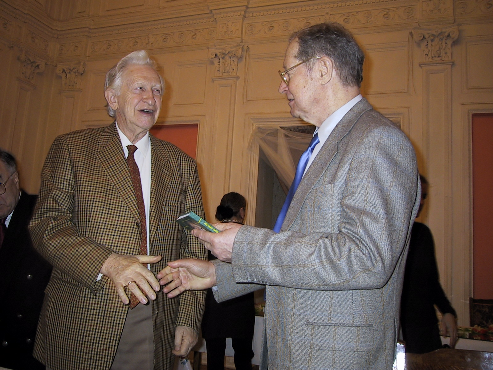 Vasily Smyslov congratulates Yuri Averbakh at his 80th birthday and presents him with a book of his own chess studies.