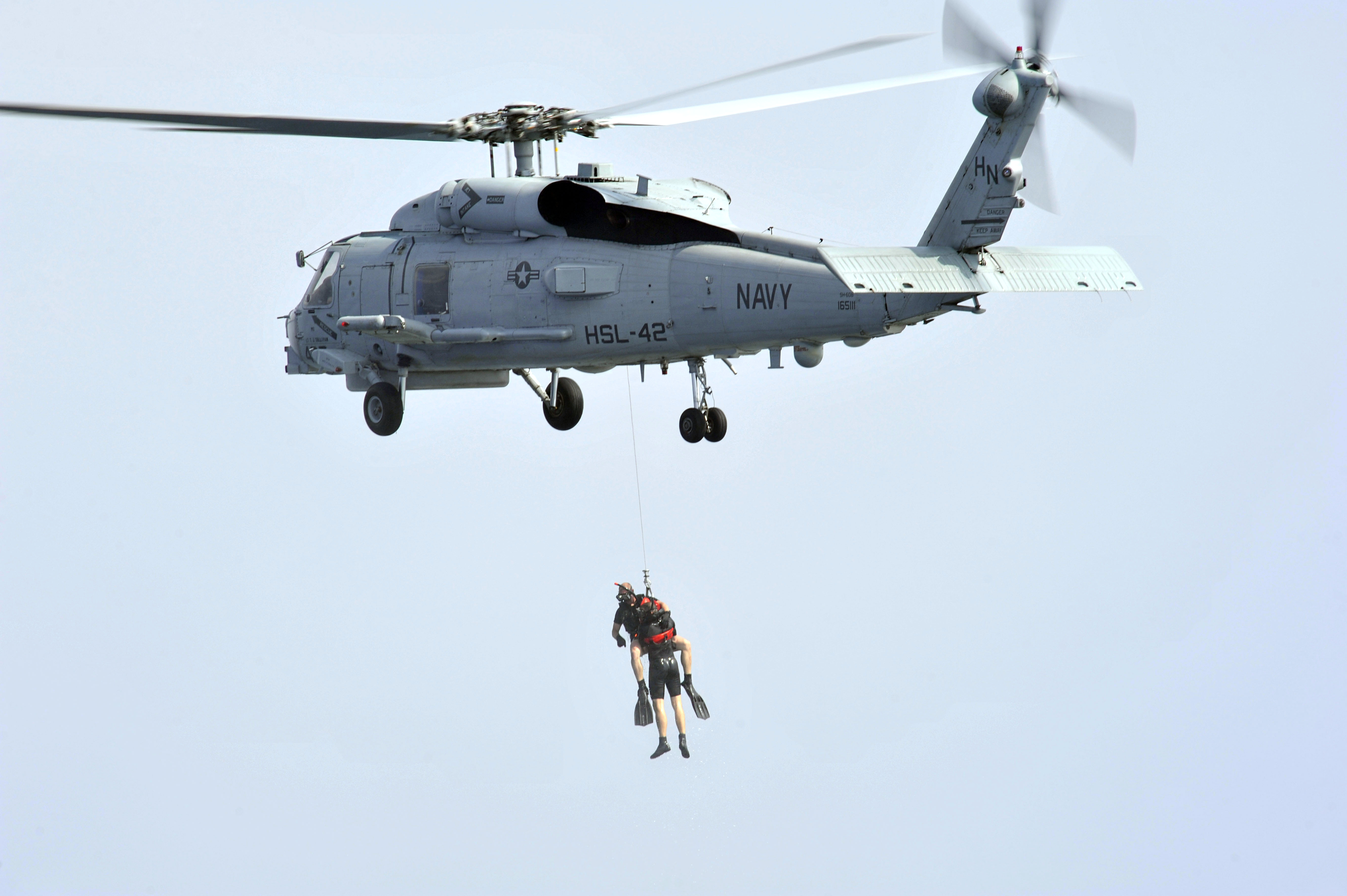 File:U.S. Navy rescue swimmers are hoisted from the water by an SH