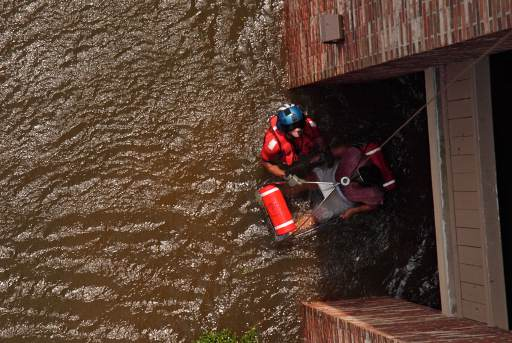 United States Coast Guard Scott D. Rady pulls a pregnant woman from her flooded New Orleans home.jpg