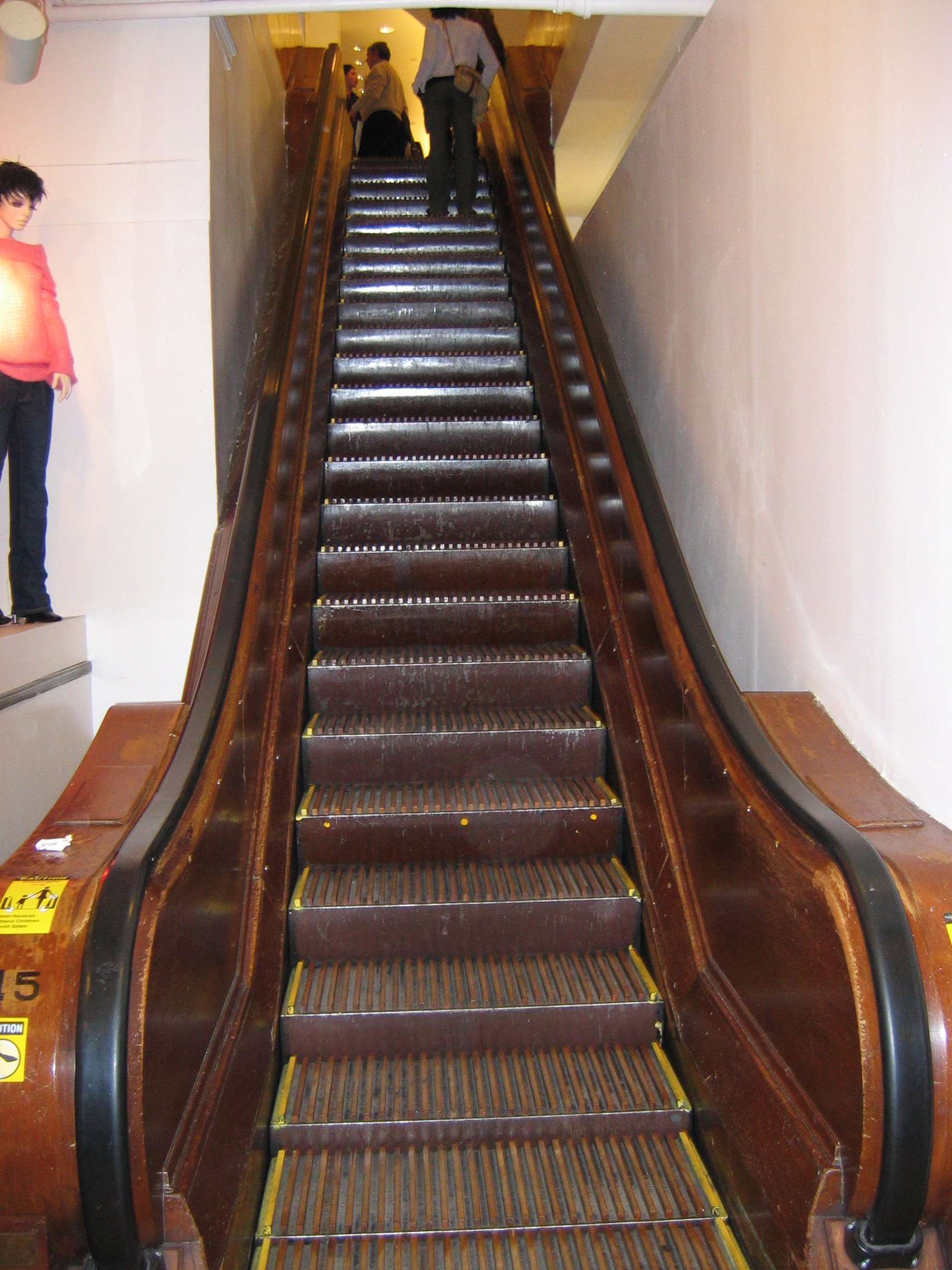 Macy's Herald Square store in New York City holds some of the more famous historic escalators. The models shown here, retrofitted with metal steps in the 1990s, are among the oldest of the store's 40 escalators. Otis