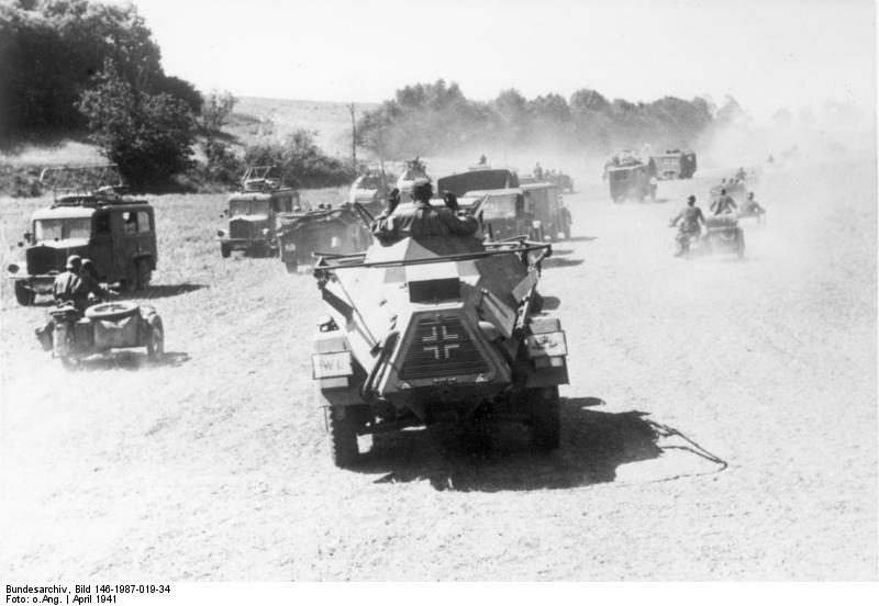 Motorcycle troops, armored cars and signals vehicles