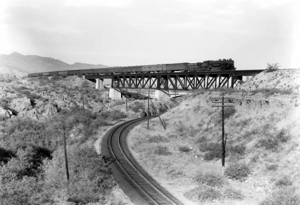 The train crossing Cienega Creek near Vail, Arizona, in 1921. Marsh Station Bridge Pima County Arizona 1921.jpg