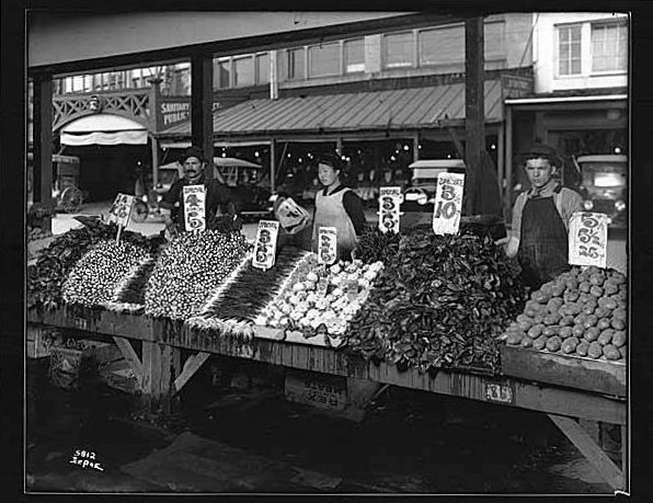 File:Pike Public Market - vegetable vendor daystalls - 1917.jpg