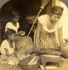 Salvadoran woman making tortillas with a tradi...
