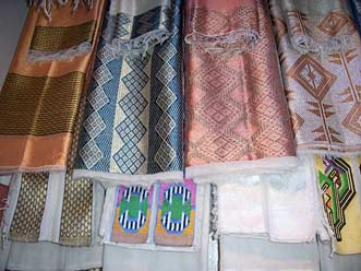 Handwoven fabrics with decorative woven borders.