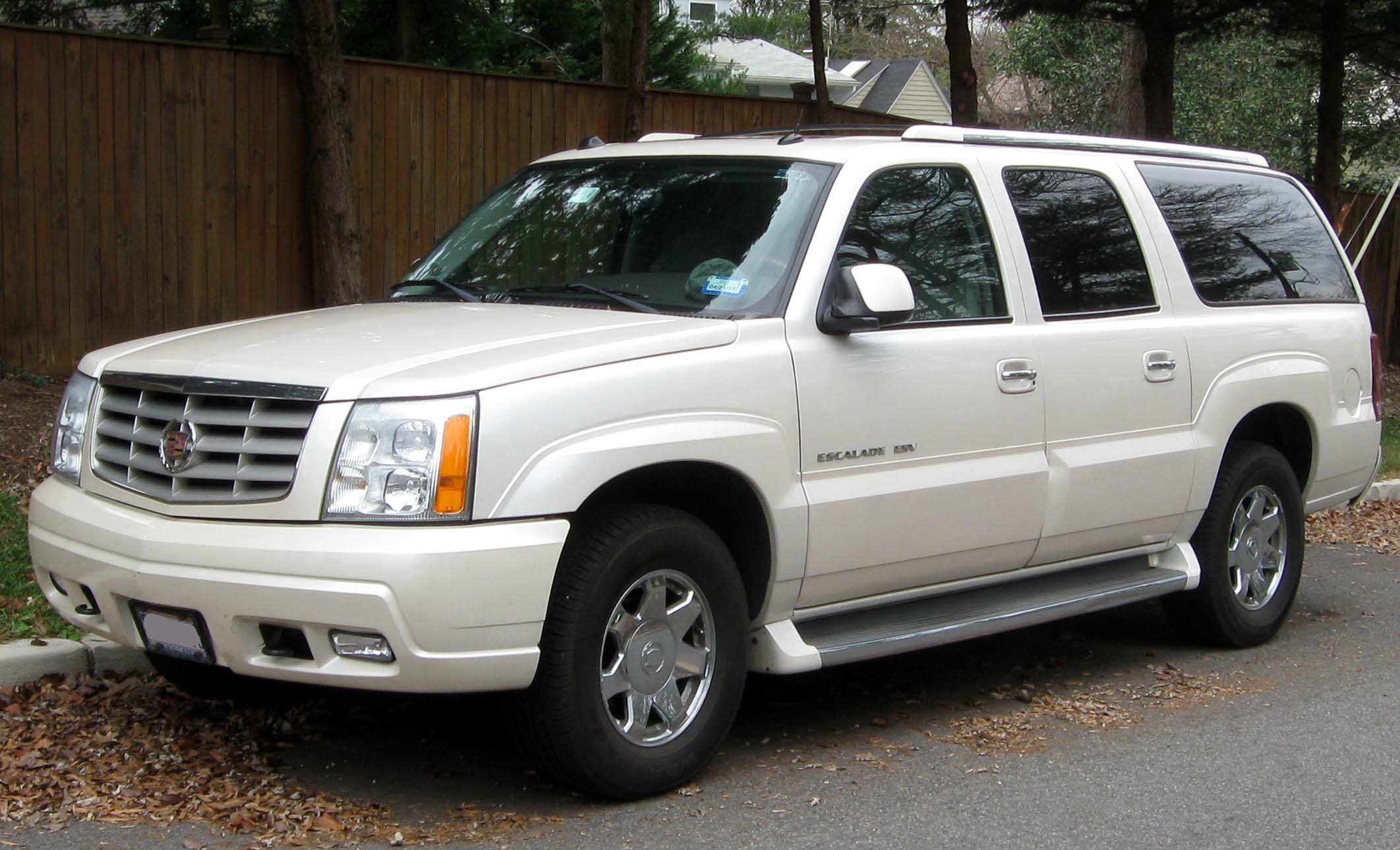 Cadillac Escalade car - Color: White  // Description: exclusive