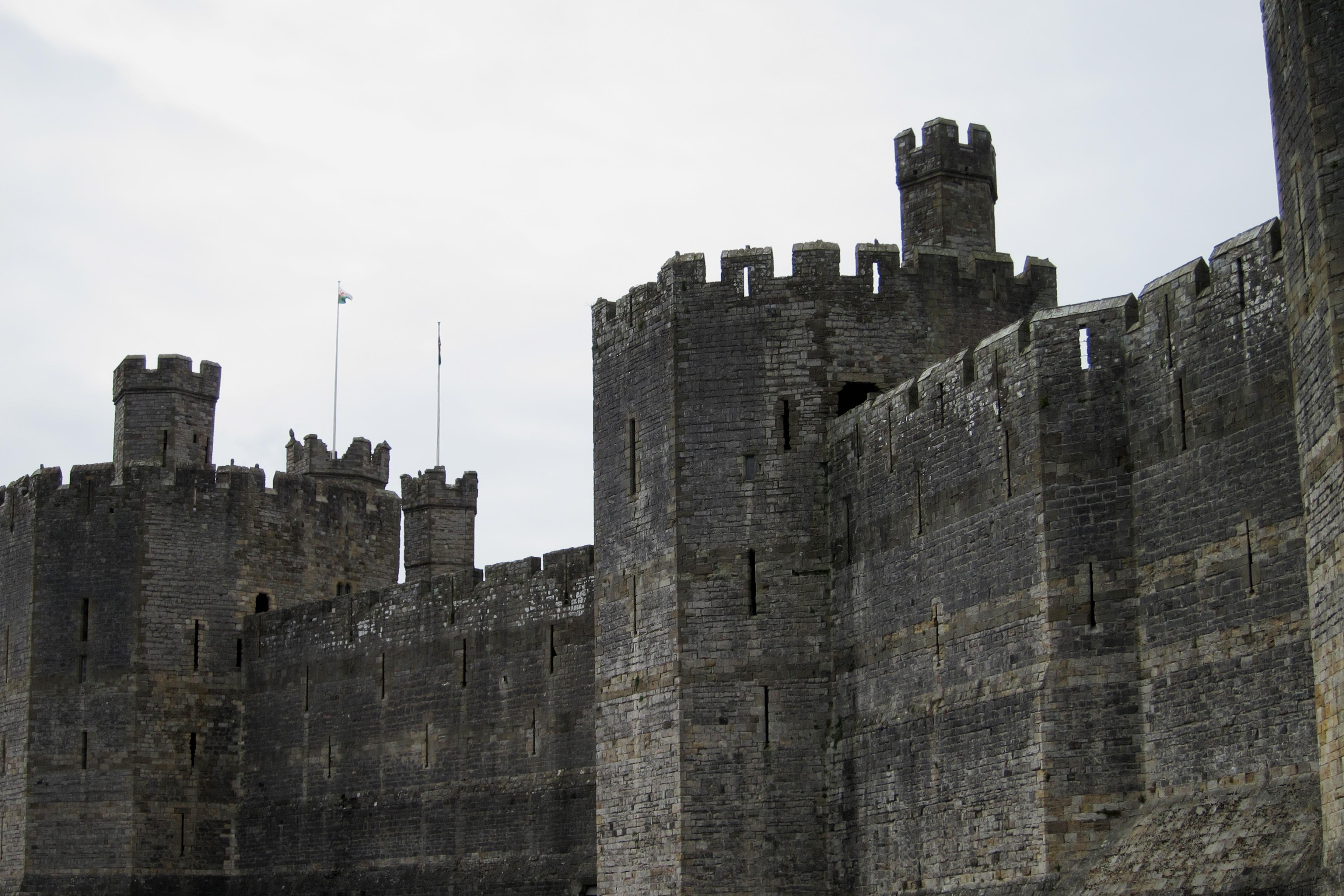 Dark castle walls reaching in the sky