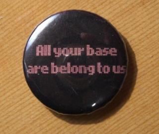 Curiosidades de los videojuegos.  Chapa_All_your_base_are_belong_to_us