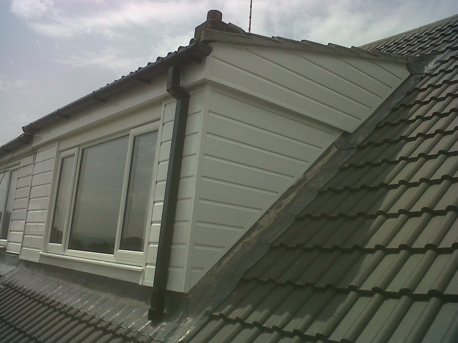 File:Concrete tile re-roof with UPVC dormer.jpg - Wikimedia Commons